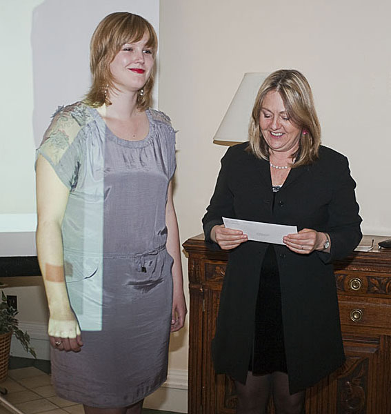Landon Mackenzie presents winner Jessica Groome with the first installment of her award