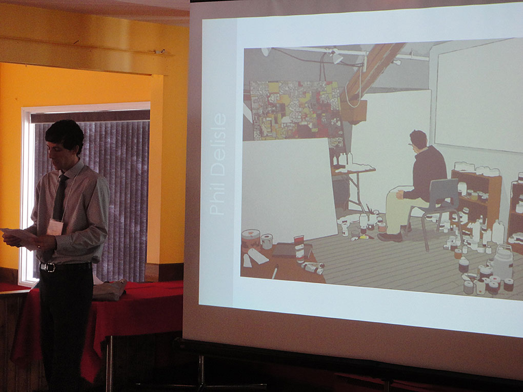 Philippe Delisle présente son travail aux membres de l'Académie durant l'assemblée générale annuelle.